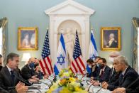 Secretary of State Antony Blinken, left, accompanied by Israeli Foreign Minister Yair Lapid, right, speaks at bilateral meeting at the State Department in Washington, Wednesday, Oct. 13, 2021. (AP Photo/Andrew Harnik, Pool)