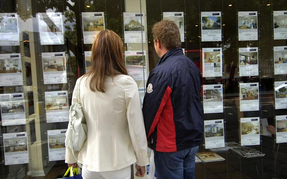 A couple standing outside an estate agent's window - Tim Ireland/PA