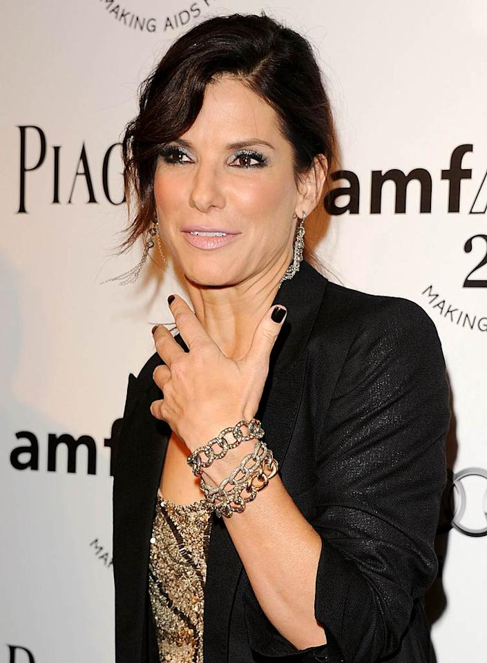 """Sandra Bullock has a """"new face"""" with """"poutier lips"""" and """"fresh-looking skin,"""" reveals <em>OK!,</em> which notes she's recently had a lot of cosmetic work performed. For how Ryan Reynolds' relationship with Blake Lively prompted her to get more surgeries, and what radical procedures she's already undergone, see what a Bullock confidante leaks to <a target=""""_blank"""" href=""""http://www.gossipcop.com/sandra-bullock-botox-radiesse-plastic-surgery-cosmetic-face-forehead-lips-mouth/"""">Gossip Cop.</a>"""