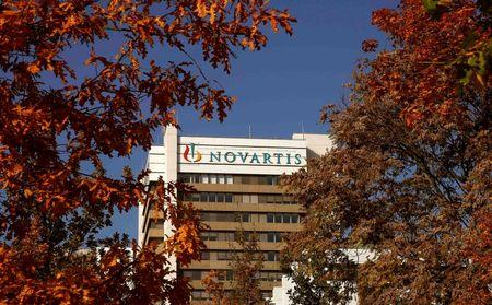 The logo of Swiss pharmaceutical company Novartis is seen on its headquarters building in Basel