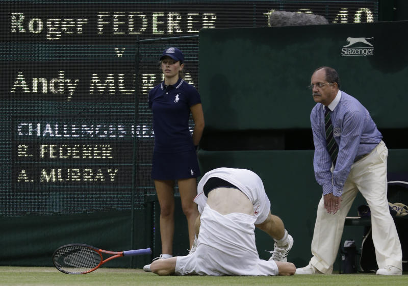 CORRECTS NAME OF PHOTOGRAPHER    Andy Murray of Britain takes a tumble during the men's singles final match against Roger Federer of Switzerland at the All England Lawn Tennis Championships at Wimbledon, England, Sunday, July 8, 2012. (AP Photo/Kirsty Wigglesworth)