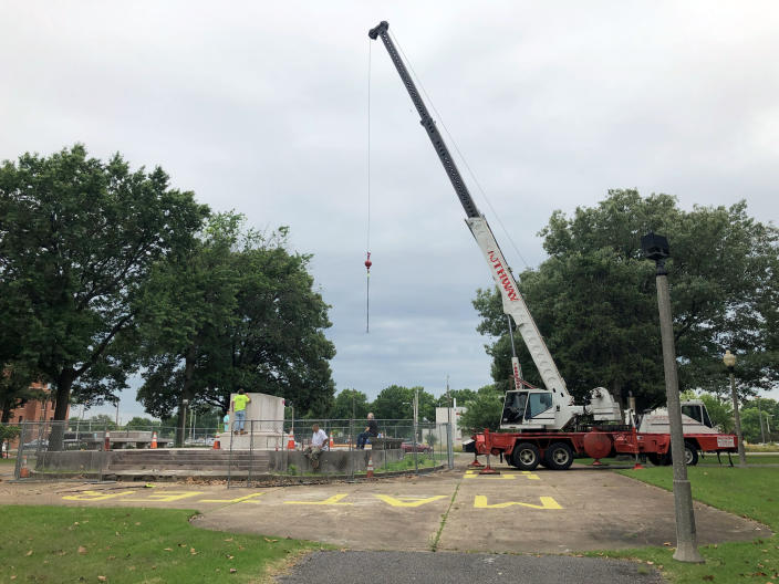 A heavy crane that will be used to help dig up the remains of former Confederate Gen. Nathan Bedford Forrest sits at a park on Tuesday, June 1, 2021, in Memphis, Tenn. The bodies of Forrest and his wife are being moved from the Memphis park, where they have been buried for decades, to a museum in Middle Tennessee. (AP Photo/Adrian Sainz)