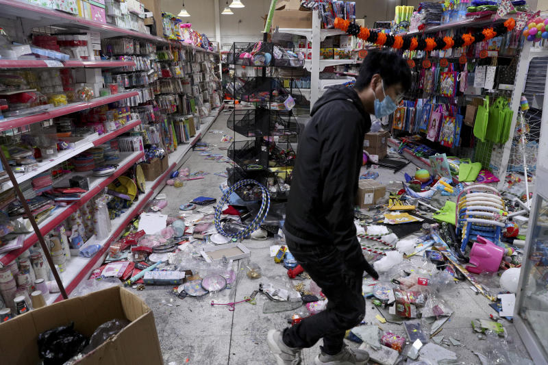 A worker cleans up a supermarket looted during protests in Santiago, Chile, Sunday, Oct. 20, 2019. Chilean President Sebastián Piñera on Saturday announced the suspension of a subway fare hike that had prompted violent student protests, less than a day after he declared a state of emergency amid rioting and commuter chaos in the capital. (Photo: Esteban Felix/AP)