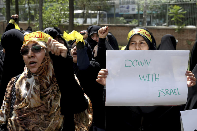 "Iranian protesters attend a rally to show their anger over the deaths of nearly 60 Palestinians along the Gaza border on Monday, inside the former U.S. embassy in Tehran, Iran, Wednesday, May 16, 2018. State media reported that Iran's President Hassan Rouhani has condemned the killing of Palestinians by Israel, saying ""Palestinians are fighting for their homeland."" (AP Photo/Ebrahim Noroozi)"