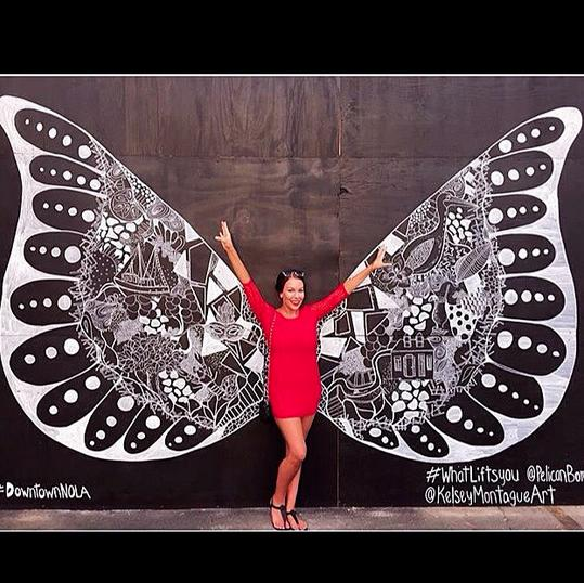 "<p>The striking artwork invites passersby to pose in front of the wings, share the image socially, and say what inspires them. Look closely at Montague's mural and you'll recognize iconic New Orleans symbols like Mardi Gras masks. (Photo: <a href=""https://instagram.com/pelicanbomb/"">Pelican Bomb/Instagram</a>)</p>"