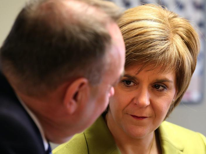 Nicola Sturgeon and Alex Salmond campaigning together in 2015PA
