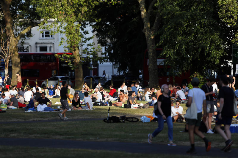 People socialise in groups on a busy Clapham Common, London, on Bank Holiday Monday after the introduction of measures to bring the country out of lockdown due to the coronavirus pandemic.
