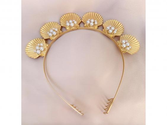 An ode to the seaside, we love the pearl detailing on this gold band (French Fashion House)