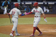 Philadelphia Phillies' Rhys Hoskins, right, is congratulated by Odubel Herrera (37) after Hoskins hit a home run during the fourth inning of a baseball game against the Miami Marlins, Thursday, May 27, 2021, in Miami. (AP Photo/Wilfredo Lee)