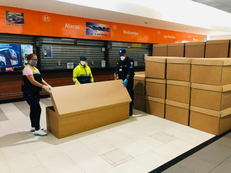 """The cardboard coffins """"will be a great help in providing a dignified burial for people who died during this health emergency,"""" the Guayaquil mayor's office tweeted"""