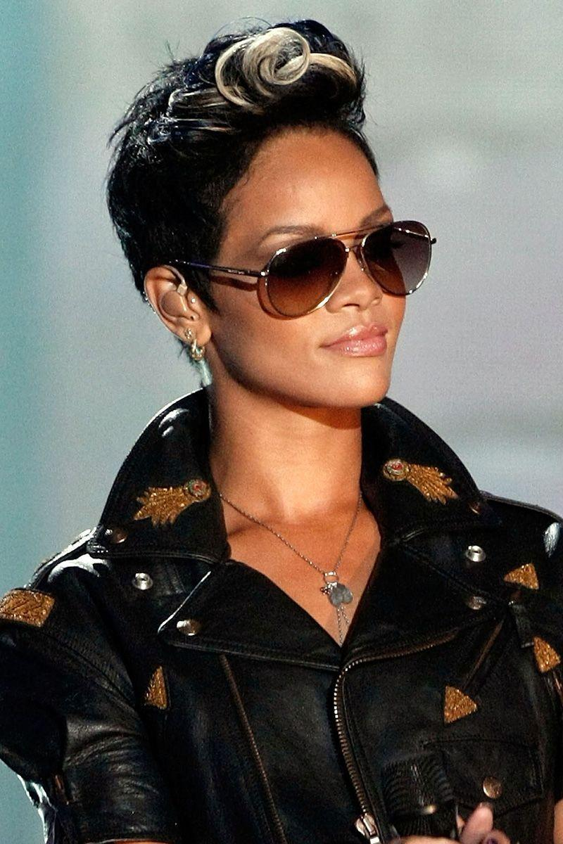 <p>Rihanna wears her short hair styled in a curled faux hawk with a platinum streak. </p>