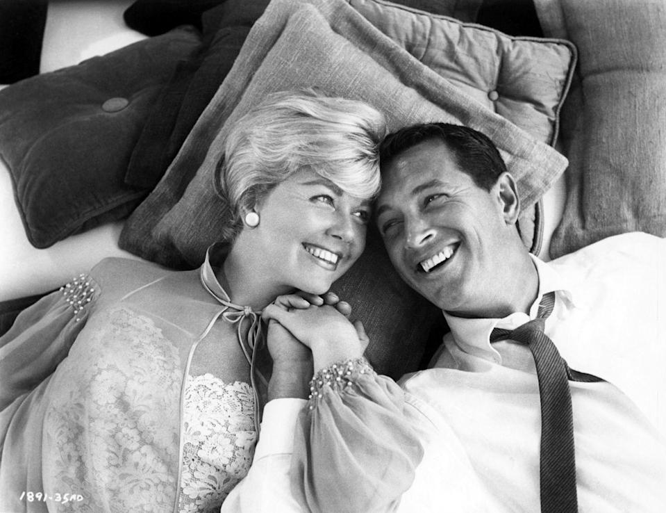 <p>Hudson smiled with famous actress Doris Day, with whom he starred in the movie <em>Pillow Talk</em>. The film was a huge hit and Hudson was voted the most popular movie star in the U.S. that year.</p>