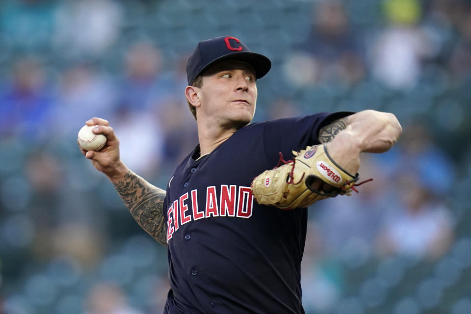 Cleveland Indians starting pitcher Zach Plesac throws to a Seattle Mariners batter during the first inning of a baseball game Thursday, May 13, 2021, in Seattle. (AP Photo/Elaine Thompson)