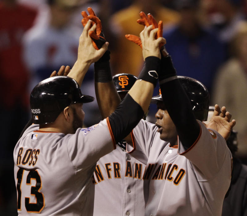 San Francisco Giants' Edgar Renteria celebrates with Cody Ross, left, after hitting a three run home run during the seventh inning of Game 5 of baseball's World Series against the Texas Rangers Monday, Nov. 1, 2010, in Arlington, Texas. (AP Photo/David J. Phillip)
