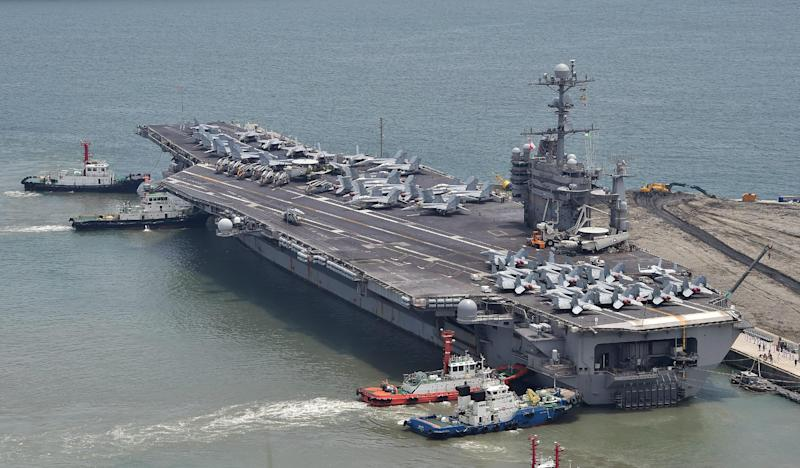 US aircraft carrier the USS George Washington arrives at the southeastern port city of Busan, South Korea on July 11, 2014 (AFP Photo/Jung Yeon-Je)
