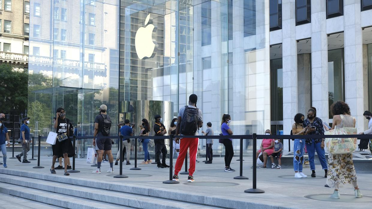 Customers are seen on line waiting to access the Apple Fifth Avenue Store as New York enters Phase 2 on June 22, 2020.
