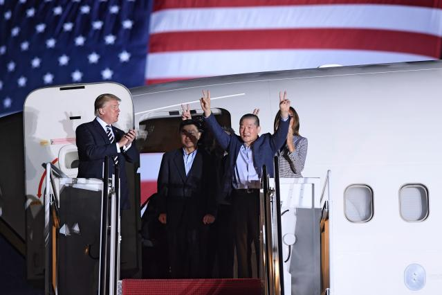 <p>President Donald Trump (L) applauds as US detainee Kim Dong-chul (2nd R) gestures upon his return with Kim Hak-song (C) and Tony Kim (behind) after they were freed by North Korea, at Joint Base Andrews in Maryland on May 10, 2018. (Photo by Saul Loeb/AFP/Getty Images) </p>