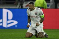 Memphis Depay's late goal took Lyon through to the last 16 as the French side drew 2-2 with RB Leipzig (AFP Photo/JEFF PACHOUD)