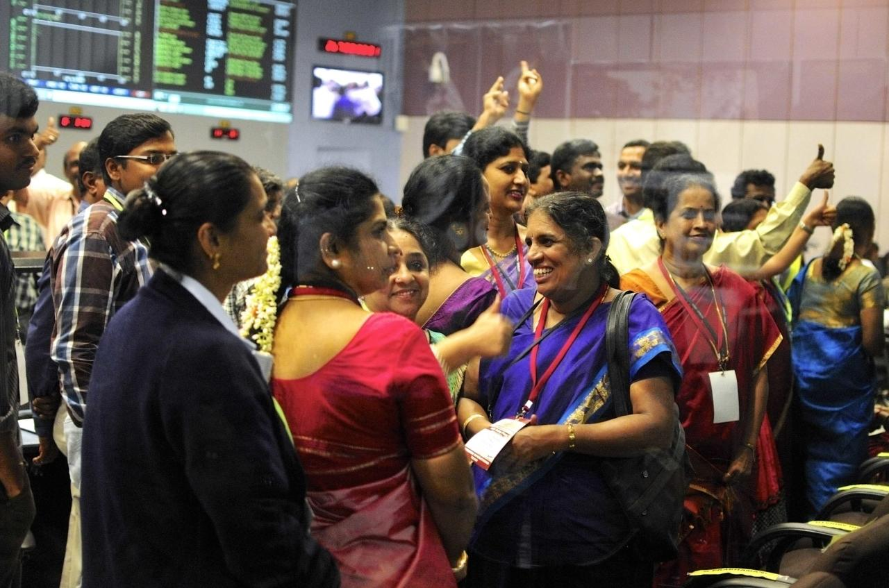"Indian Space Research Organization (ISRO) scientists and engineers cheer after India's Mars orbiter successfully entered the red planet's orbit, at their Spacecraft Control Center, in this photo taken through a glass panel, in the southern Indian city of Bangalore September 24, 2014. India's low-cost mission to Mars successfully entered the red planet's orbit on Wednesday, crowning what Prime Minister Narendra Modi said was a ""near impossible"" push to complete the trip on its maiden attempt. The Mars Orbiter Mission cost $74 million or about three-quarters of the amount to make the Oscar-winning movie 'Gravity' about astronauts stranded in space. REUTERS/Abhishek N. Chinnappa (INDIA - Tags: SCIENCE TECHNOLOGY)"