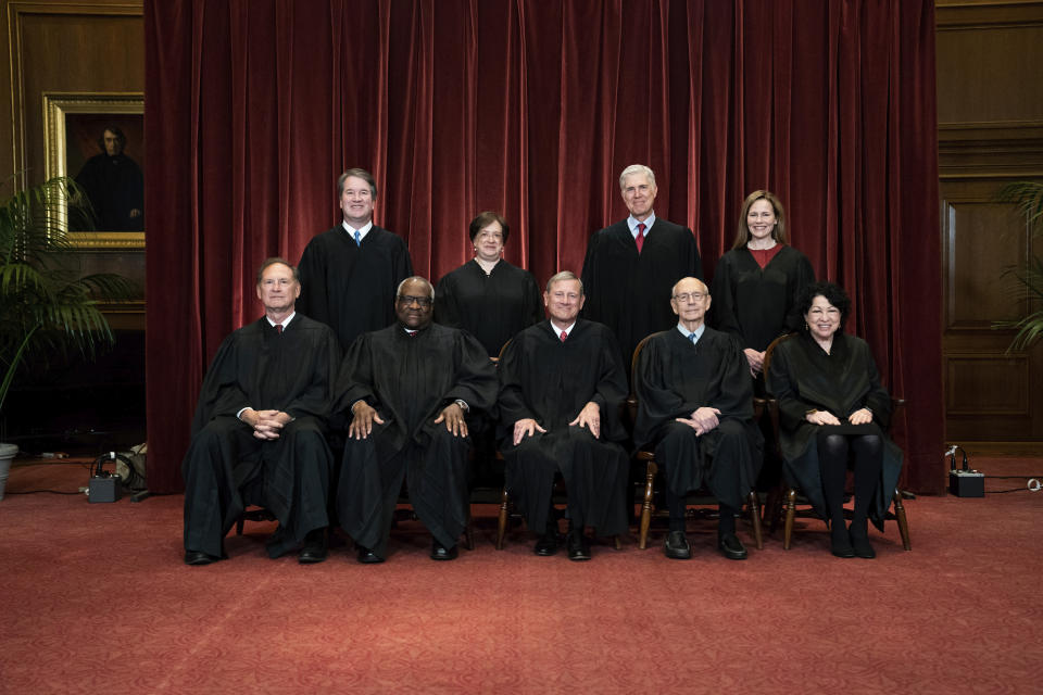 FILE - In this April 23, 2021, file photo members of the Supreme Court pose for a group photo at the Supreme Court in Washington. Seated from left are Associate Justice Samuel Alito, Associate Justice Clarence Thomas, Chief Justice John Roberts, Associate Justice Stephen Breyer and Associate Justice Sonia Sotomayor, Standing from left are Associate Justice Brett Kavanaugh, Associate Justice Elena Kagan, Associate Justice Neil Gorsuch and Associate Justice Amy Coney Barrett. (Erin Schaff/The New York Times via AP, Pool, File)