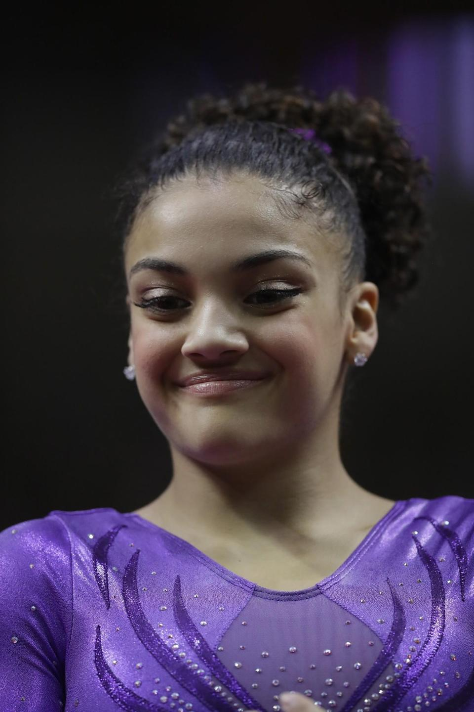 <p>Lauren 'Laurie' Hernandez won medals in all four events at the junior world championships. She finished second all-around after Biles in the Olympic Trials. (Getty) </p>