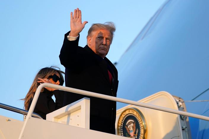 President Donald Trump waves as he boards Air Force One at Andrews Air Force Base, Maryland, Wednesday, Dec. 23, 2020. Trump is traveling to his Mar-a-Lago resort in Palm Beach, Florida.