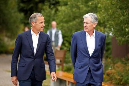 """Federal Reserve Chair Jerome Powell and Governor of the Bank of England, Mark Carney, are seen during the three-day """"Challenges for Monetary Policy"""" conference in Jackson Hole, Wyoming"""
