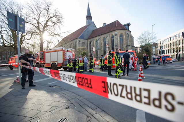<p>An armed Police officer and first responders are seen at the scene when several people were killed and injured when a car ploughed into pedestrians in Muenster, western Germany on April 7, 2018. (Photo: Friso Gentsch/AFP/Getty Images) </p>