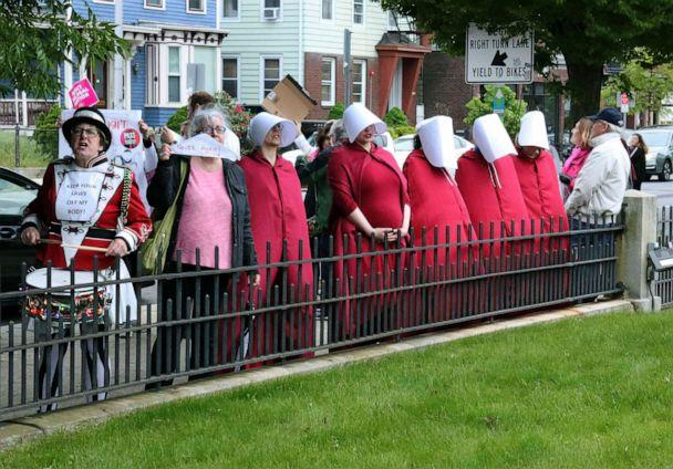 PHOTO: Women dressed as characters from the 'The Handmaid's Tale' protest in Providence, R.I., on In this May 23, 2019. (Jennifer Mcdermott/AP)
