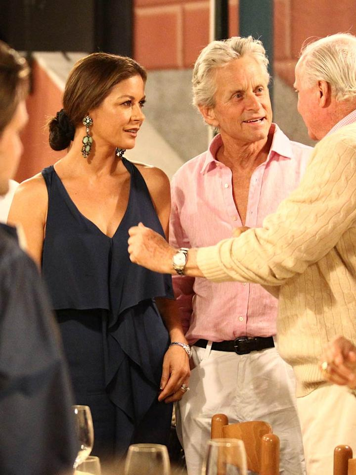 """Michael Douglas and Catherine Zeta-Jones looked tanned and relaxed while vacationing in Portofino, Italy. And why wouldn't they? The two are spending a month cruising around the Mediterranean on a yacht! <a href=""""http://www.splashnewsonline.com"""" target=""""new"""">Splash News</a> - July 25, 2011"""