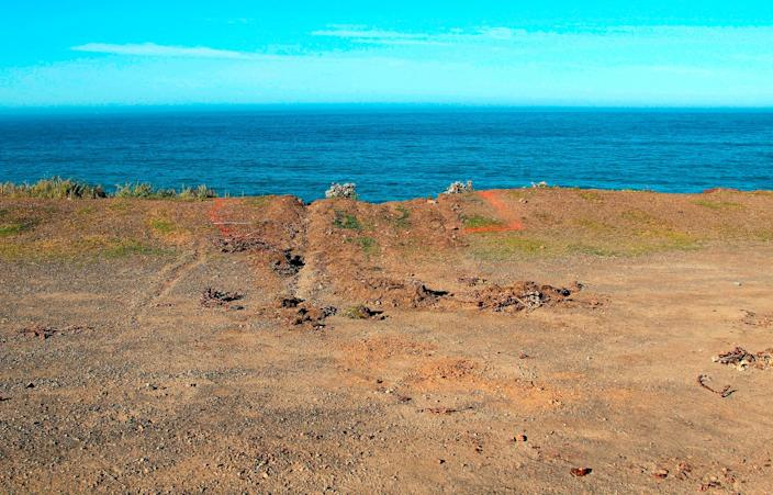 This March 29, 2018, file photo shows ruts cut into the clifftop where the SUV of Jennifer and Sarah Hart that went off the cliff was hauled up and over by a tow truck off the Pacific Coast Highway near Westport, Calif. A California Highway Patrol investigator testified Thursday, April 4, 2019 that Sarah Hart searched whether death by drowning was relatively painless hours before her wife drove an SUV off a cliff, killing them and six adopted children in waters below.