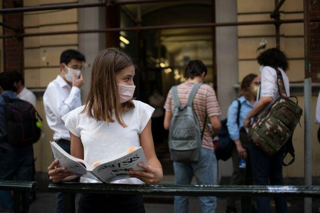 TURIN, ITALY - JUNE 16: A student waits with a book for a high school exam outside the Liceo Classico Massimo D'Azeglio on June 16, 2021 in Turin, Italy. High-school graduation exams commence today for the second time since the beginning of the COVID-19 pandemic. (Photo by Stefano Guidi/Getty Images) (Photo: Stefano Guidi via Getty Images)