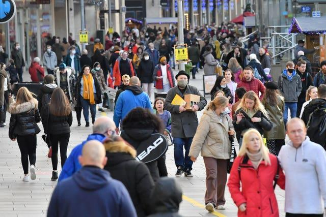 People shopping in Cardiff city centre on the last Saturday shopping day before Christmas (Ben Birchall/PA)