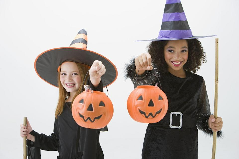 """<p>There are so many reasons why witch costumes are a Halloween classic. One is that they're incredibly easy to concoct at the last possible second.</p><p><strong><a href=""""https://www.countryliving.com/diy-crafts/a22366842/kids-witch-costume/"""" rel=""""nofollow noopener"""" target=""""_blank"""" data-ylk=""""slk:Get the tutorial"""" class=""""link rapid-noclick-resp"""">Get the tutorial</a>.</strong></p><p><a class=""""link rapid-noclick-resp"""" href=""""https://www.amazon.com/s/ref=nb_sb_noss_1?url=search-alias%3Dtoys-and-games&field-keywords=witch+hats&tag=syn-yahoo-20&ascsubtag=%5Bartid%7C10050.g.23785711%5Bsrc%7Cyahoo-us"""" rel=""""nofollow noopener"""" target=""""_blank"""" data-ylk=""""slk:SHOP WITCH HATS""""><strong>SHOP WITCH HATS</strong></a><strong><br></strong></p>"""
