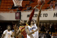 Iowa State guard Jalen Coleman-Lands (5) blocks and fouls Oklahoma State guard Avery Anderson III (0) shot during the second half of the NCAA college basketball game in Stillwater, Okla., Tuesday, Feb. 16, 2021. (AP Photo/Mitch Alcala)