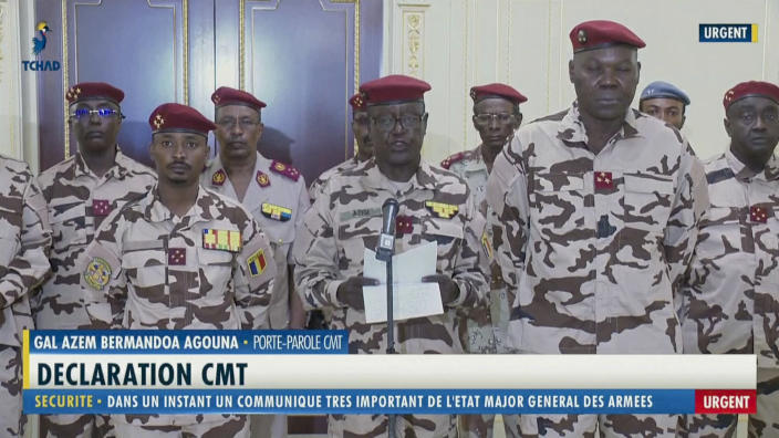 "Chad army spokesman General Azem Bermandoa Agouna, center, announces the death of Chadian President Idriss Deby Itno, on state television Tuesday, April 20, 2021. Deby, who ruled the central African nation for more than three decades, was killed on the battlefield Tuesday, April 20, 2021 in a fight against rebels, the military announced on national television and radio. Onscreen writing in French reads ""General Azem Bermandoa Agouna - Spokesman of the Transitional Military Council. Declaration of the Transitional Military Council. Security - In a moment a very important communique from the General Staff of the Military - Urgent"". (Tele Tchad via AP)"