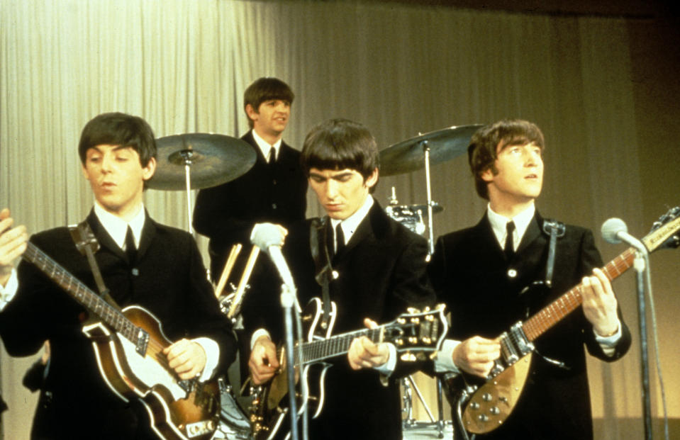 Paul McCartney, Ringo Starr, George Harrison, and John Lennon perform around 1963. (Photo: King Collection/Photoshot/Getty Images)