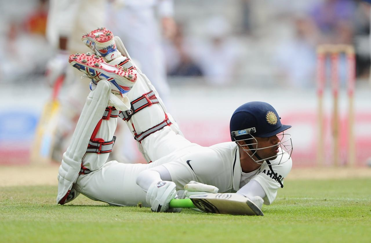 LONDON, ENGLAND - AUGUST 21:  Rahul Dravid of India dives to make his ground when on 99 runs during day four of the 4th npower Test Match between England and India at The Kia Oval on August 21, 2011 in London, England.  (Photo by Gareth Copley/Getty Images)