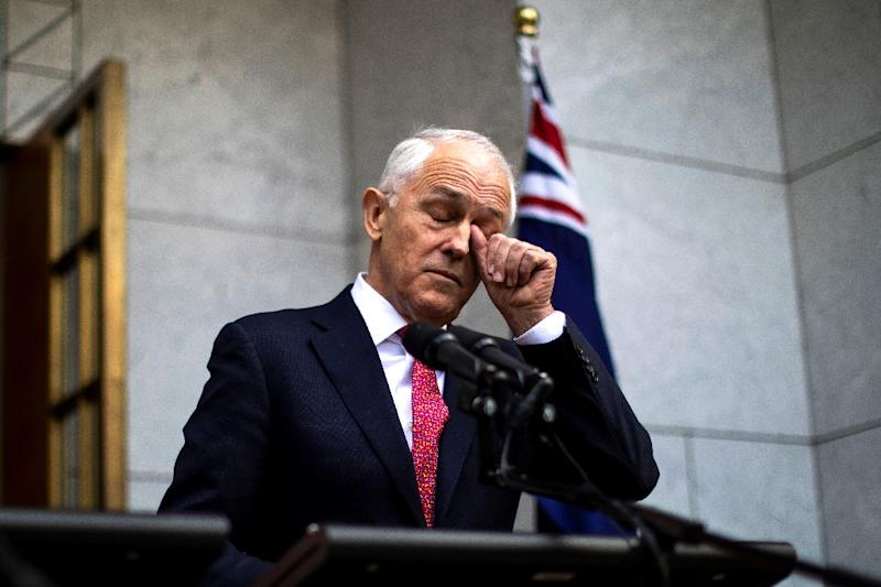 Beleaguered Australian PM Turnbull clings to power