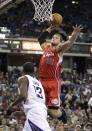 Los Angeles Clippers forward Blake Griffin, right, goes up for the dunk over Sacramento Kings guard Tyreke Evans during the during the first quarter of an NBA basketball game in Sacramento, Calif., Tuesday, March 19, 2013.(AP Photo/Rich Pedroncelli)