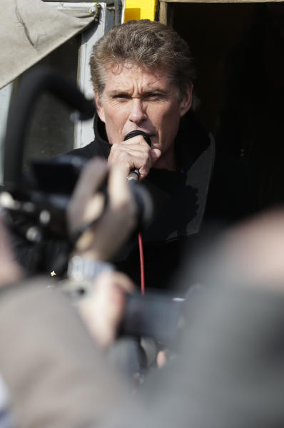 """US actor David Hasselhoff speaks to the crowed from a truck as he attends a protest against the removal of a section of the East Side Gallery, a historic part of the former Berlin Wall, in Berlin, Sunday, March 17, 2013. Hasselhoff is fondly remembered by many Germans for releasing a song called """"Looking for Freedom"""" shortly before the fall of the Wall in 1989. (AP Photo/Markus Schreiber)"""