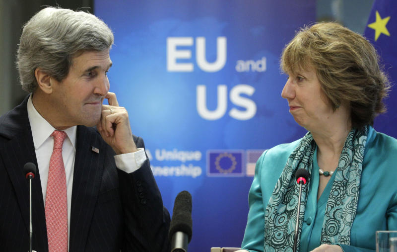 EU foreign policy chief Catherine Ashton, right, and U.S. Secretary of State John Kerry look at each other at the European External Action Service headquarters in Brussels on Wednesday April 2, 2014. Kerry met with Ashton and leading EU officials to discuss the dependency of the 28-nation bloc on Russian energy provisions and seek ways for a better diversification of oil and gas imports in the wake of the Crimean crisis. (AP Photo/Yves Logghe)