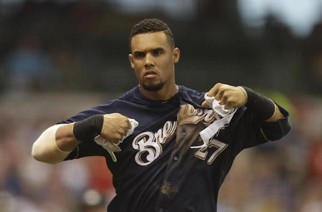 Milwaukee Brewers' Carlos Gomez rips apart his batting gloves after striking out during the fifth inning of a baseball game against the St. Louis Cardinals Saturday, July 12, 2014, in Milwaukee. (AP Photo/Jeffrey Phelps)
