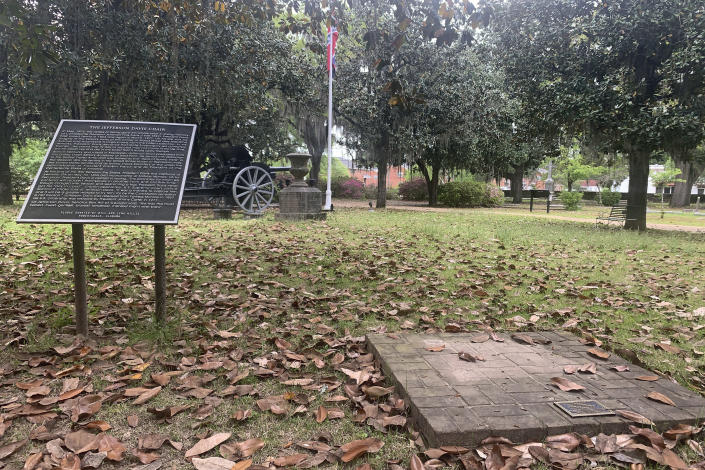 A brick base sits empty Tuesday, April 13, 2021, where chair carved out of limestone honoring Confederate President Jefferson Davis was stolen from Confederate Memorial Circle, a private section of Live Oak Cemetery in Selma, Ala. Police recovered the chair in New Orleans. (AP Photo/Kim Chandler)
