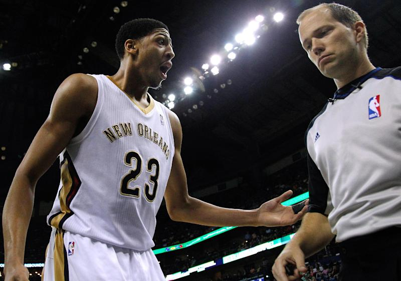 New Orleans Pelicans forward Anthony Davis (23) talks to an official during the first half of an NBA basketball game against the Boston Celtics in New Orleans, Sunday, March 16, 2014. (AP Photo/Jonathan Bachman)