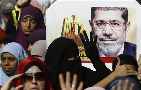 Supporters of ousted Egyptian President Mursi take part in a protest in Cairo