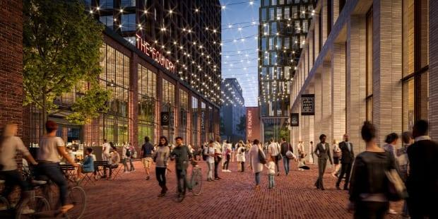 The group seeks to retain the site's most important historical buildings, known as the Foundry and the Machine Shop. The above rendering shows the proposed 'Foundry Lane' public area.