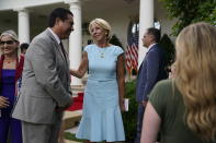 """Education Secretary Betsy DeVos speaks with Jesus Marquez, President of Marquez Group Strategies, after President Donald Trump signed an executive order on the """"White House Hispanic Prosperity Initiative,"""" in the Rose Garden of the White House, Thursday, July 9, 2020, in Washington. (AP Photo/Evan Vucci)"""