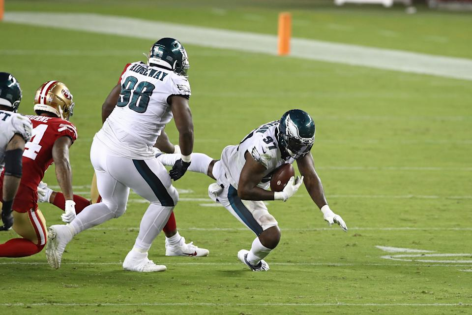Malik Jackson gave the Eagles an extra few inches on a play when he nudged the ball with his foot after the referee set it on the line of scrimmage. (Photo by Ezra Shaw/Getty Images)