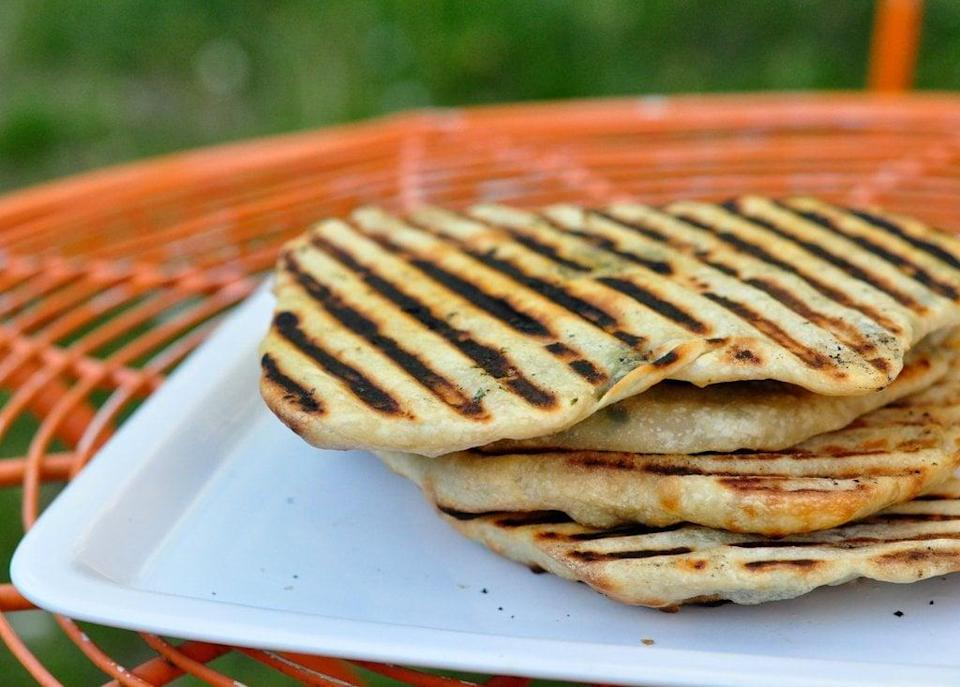 "<p>These cheese- and herb-filled flatbreads can be made ahead of time and stored in the fridge for one to two days. </p> <p><strong>Get the recipe:</strong> <a href=""https://www.popsugar.com/food/Grilled-Flatbread-Recipe-18344497"" class=""link rapid-noclick-resp"" rel=""nofollow noopener"" target=""_blank"" data-ylk=""slk:grilled flatbreads stuffed with cheese and herbs"">grilled flatbreads stuffed with cheese and herbs</a></p>"